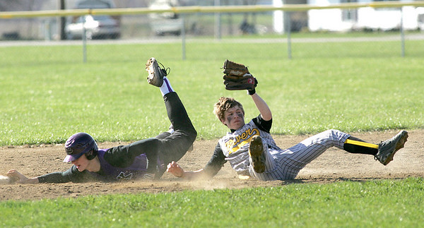 Keystone's #32 Caleb Schillace knows he's out at second base; #6 Black River Robbie Duche' defends and is bowled over but holds on to the ball.  picture o3 of 3.   photo by Chuck Humel