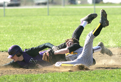 Keystone's #32 Caleb Schillace knows he's out at second base; #6 Black River Robbie Duche' defends and is bowled over but holds on to the ball.    photo by Chuck Humel