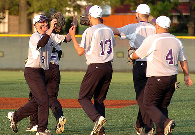 Keystone's #3 Tyler Young high-fives pitcher #13 Brandyn Sittinger as the team celebrates its win over EC.