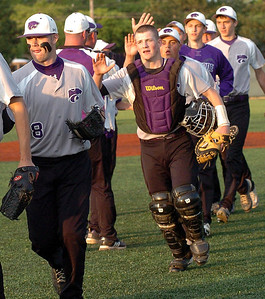 Keystone high-fives the coachs as the celebrate their win over EC.
