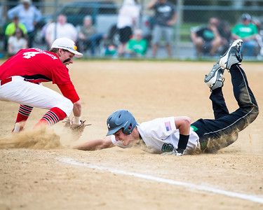 Columbia's Lance Boise dives back to first under the tag of Lutheran West's Alex Robinson during a game Monday, April 25. JOE COLON/CHRONICLE