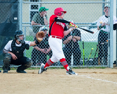 Lutheran West's Owen Albers drives in a run as Columbia catcher Sam Krizek sets up behind the plate during a game Monday, April 25. JOE COLON/CHRONICLE