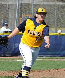 Olmsted Falls pitcher Collin Romel tosses to first base for an out May 3. STEVE MANHEIM/CHRONICLE