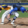 Midview's Dylan Brister beats out a bunt single as Olmsted Falls first baseman Charlie Broski tries to tag him in the first inning May 3.  STEVE MANHEIM/CHRONICLE