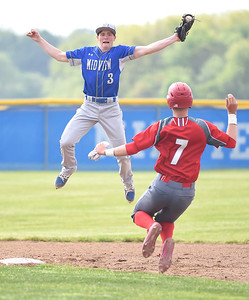 KRISTIN BAUER | CHRONICLE Midview High School shortstop Cam Hondis (3) fails to catch and secure the ball in time to tag Elyria High School's Devan Nail (7) out at second on Friday afternoon, May 12.