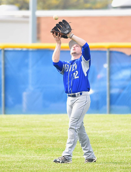 KRISTIN BAUER | CHRONICLE Midview High School right fielder Sam Butler (12) catches a pop fly hit during a game against Elyria High School on Friday afternoon, May 12.