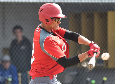 KRISTIN BAUER | CHRONICLE Elyria High School's Javon Harvey (13) bats against Midview on Friday afternoon, May 12.