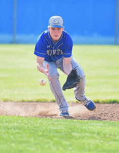 KRISTIN BAUER | CHRONICLE Midview High School shortstop Cam Hondis (3) fields a ground ball during a game against Elyria High School on Friday afternoon, May 12.