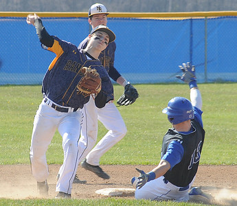 North Ridgeville's Evan Truelson attempts to complete a double play as Midview runner Dylan Brister slides into second in the first inning April 14. STEVE MANHEIM/CHRONICLE