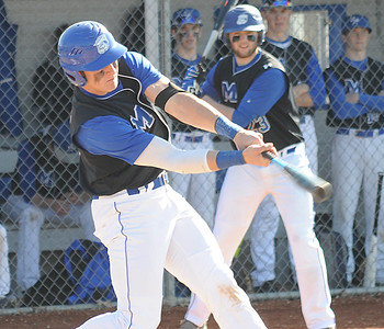 Midview's Dylan Brister hits an RBI single in the first inning April 14. STEVE MANHEIM/CHRONICLE