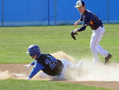 Midview's Dom Fleming steals second base before the ball reaches North Ridgeville's Carson Schneller in the first inning April 14. STEVE MANHEIM/CHRONICLE