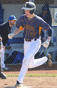 North Ridgeville's Evan Truelson scores on a Midview error in the first inning April 14. STEVE MANHEIM/CHRONICLE