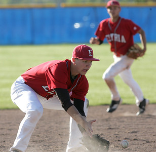 Elyria's #13 Chris Emerson fields a grounder late in the game.    photo by Chuck Humel