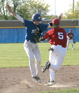 Elyria's #5 Troy Goscewski tags Midview runner #9 Ryan Smith on his way to third. It would have been a force out anyway on an easy grounder.     photo by Chuck Humel