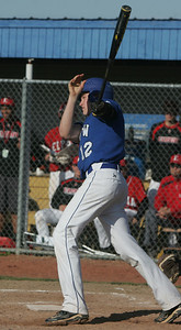 Midview's #12 Cody Callaway hits a two-RBI single.   photo by Chuck Humel