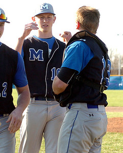 Midview's catcher #13 greets his pitcher #10 Eric Lauer after his game.
