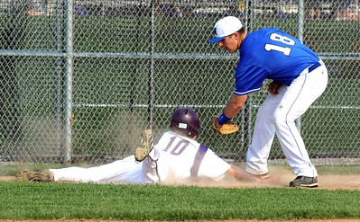 Vermilion 10 Cory Fox dives safe back into third base in front of Midview Norman Getzlaff in third inning Apr. 15.  Steve Manheim