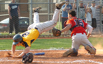 Bot of the 2nd - AdmKiing's #8 Shawn Hazelwood tries to leap over the tag of Southview's #15 Pablo Montanez, He was out.