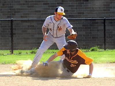 Avon Lake's Jaret Kuhar beats the tag at third base by North Ridgeville's Nate Kisel on April 26. STEVE MANHEIM / CHRONICLE