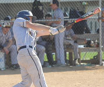 North Ridgeville's Mike Richmond hits a double in the second inning April 26.  STEVE MANHEIM / CHRONICLE
