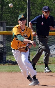 Amherst's Brian D'Andrea throws to first base in a game against Avon on Thursday, May 19. STEVE MANHEIM/CHRONICLE