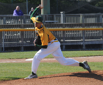 Xavier Moore pitches for Amherst against Avon on May 19. STEVE MANHEIM/CHRONICLE