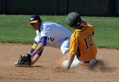 Amherst's Isaac Walts steals second base before the tag by Avon's Dom Massa on May 19. STEVE MANHEIM/CHRONICLE