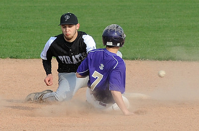 Vermilion's Noah Cacciatore steals second base as the ball gets away from Perkins' Anthony Jolly during Friday's game.  STEVE MANHEIM / CHRONICLE