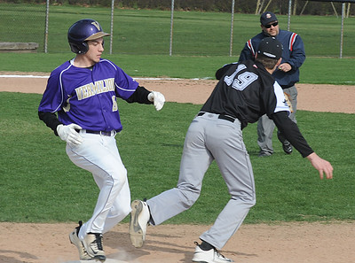 Vermilion's Joby Pfeil beats out a bunt for a single before the ball reaches Perkins' Cam Anderson in the second inning April 14.  STEVE MANHEIM / CHRONICLE