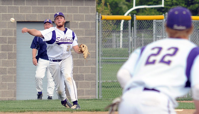Vermilion Cameron Zima makes a put out to first baseman Wesley White May 5.  Steve Manheim