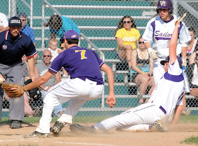 Vermilion's Cameron Zima slides safe at home in front of the tag by Avon's Cody Schroeder in third inning May 5.  Steve Manheim/CT