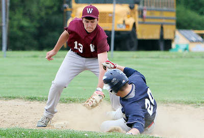 Wellington's Kevin Scott puts the tag down on Oberlin's Liam McMillin for the final out in the top of the seventh inning in the sectional game yesterday at Wellington High School. (CT photo by Anna Norris.)