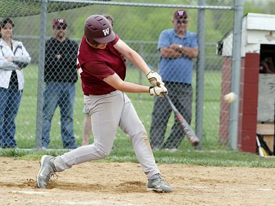 Wellington's Erik Fehlan gets a hit in the bottom of the eighth inning against Oberlin in the sectional game yesterday at Wellington High School. Wellington won 5-4 in extra innings. (CT photo by Anna Norris.)