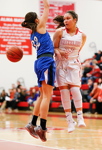 Wadsworth's Sophia Fortner throws an around the back pass against Brunswick's Eileen Salisbury during the second quarter. (RON SCHWANE / GAZETTE)