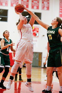 Wadsworth's Peyton Banks shoots over Medina's Klara Bergholtz during the second quarter. (RON SCHWANE / GAZETTE)