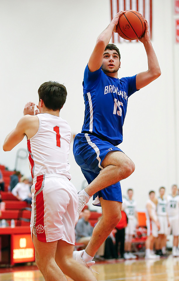 Brunswick's Danny Dakdouk scores over Wadsworth's Christian Szalay during the fourth quarter of Hoopla. (RON SCHWANE / GAZETTE)