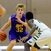Avon's Ryan Maloy matches up against GlenOak's Darius Stokes during a game Sunday. JESSE GRABOWSKI / CHRONICLE