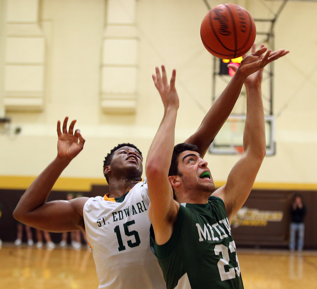 Medina's Jim Daw battles St. Edward's Kevin Dever for a rebound during the second half. AARON JOSEFCZYK/GAZETTE
