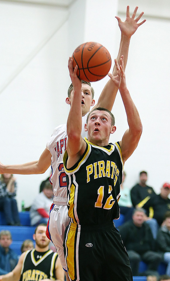 Black River's Allan Benson goes up for a shot against Mapleton's Logan Hensel during the second quarter. (RON SCHWANE / GAZETTE)