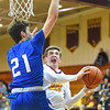 KRISTIN BAUER / CHRONICLE  <br /> Avon Lake High School's Nick Marsh (22) jumps to take a shot as Midview High School's Gage Carnes (21) attempts to block his shot on Friday night, January 19.