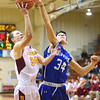 KRISTIN BAUER / CHRONICLE  <br /> Avon Lake High School's Ryan Shinko (24) jumps to take a shot as Midview High School's Jonny Manning (34) guards him on Friday night, January 19.