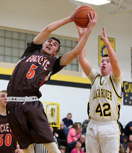 Buckeye's Braeden Stauffer grabs a rebound before Black River's Brennan Scheck can get to the ball during the second quarter. AARON JOSEFCZYK/GAZETTE