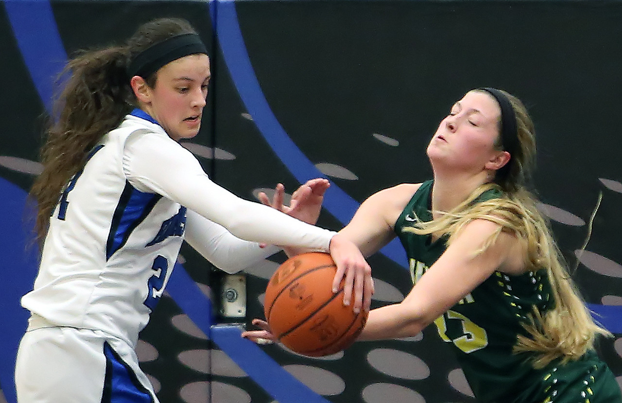 Brunswick's Olivia Andrew, left, and Medina's Jessie Holzman fight for a rebound during the second quarter. (RON SCHWANE / GAZETTE)