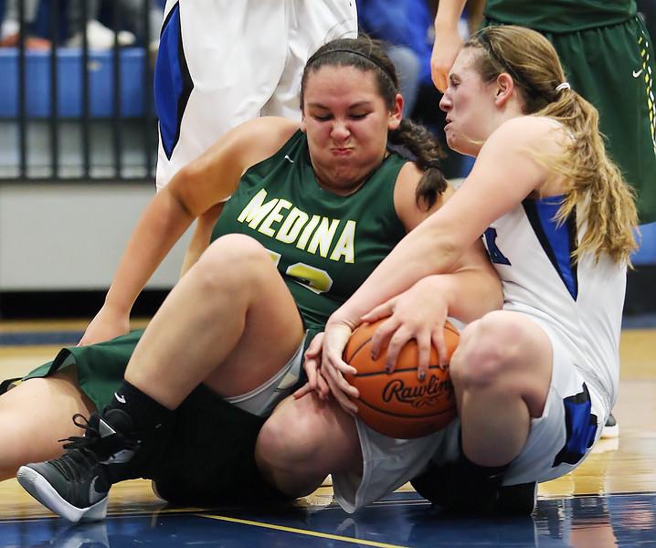 Medina's Emma Bobey and Brunswick's Paige Billetz  battle for a loose ball during the second quarter. (RON SCHWANE / GAZETTE)