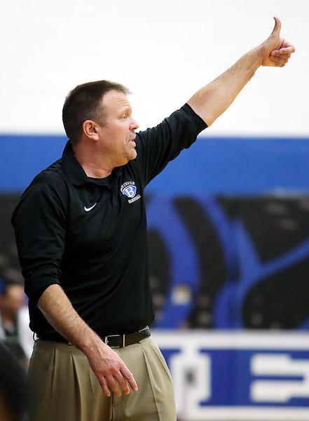 Brunswick head coach Joe Mackey signals his team against Solon during the third quarter. (RON SCHWANE / GAZETTE)