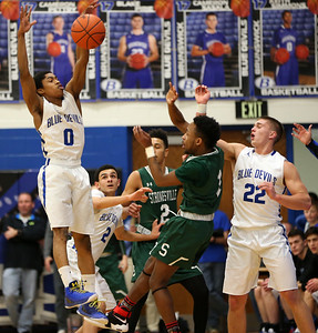 Brunswick's Keith Simmons knocks down a pass from Strongsville's Andrew Nelson with help from teammate Blake Pirie during the first half. AARON JOSEFCZYK / GAZETTE