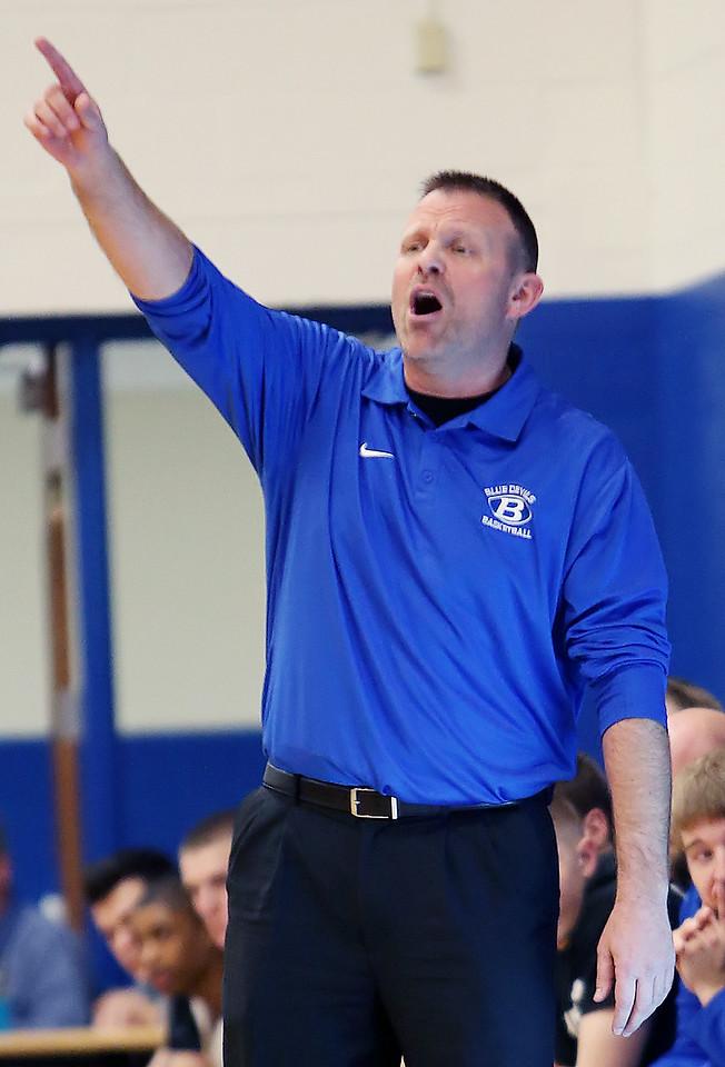 Brunswick head coach Joe Mackey directs his team against Shaker Heights during the first quarter. (RON SCHWANE / GAZETTE)