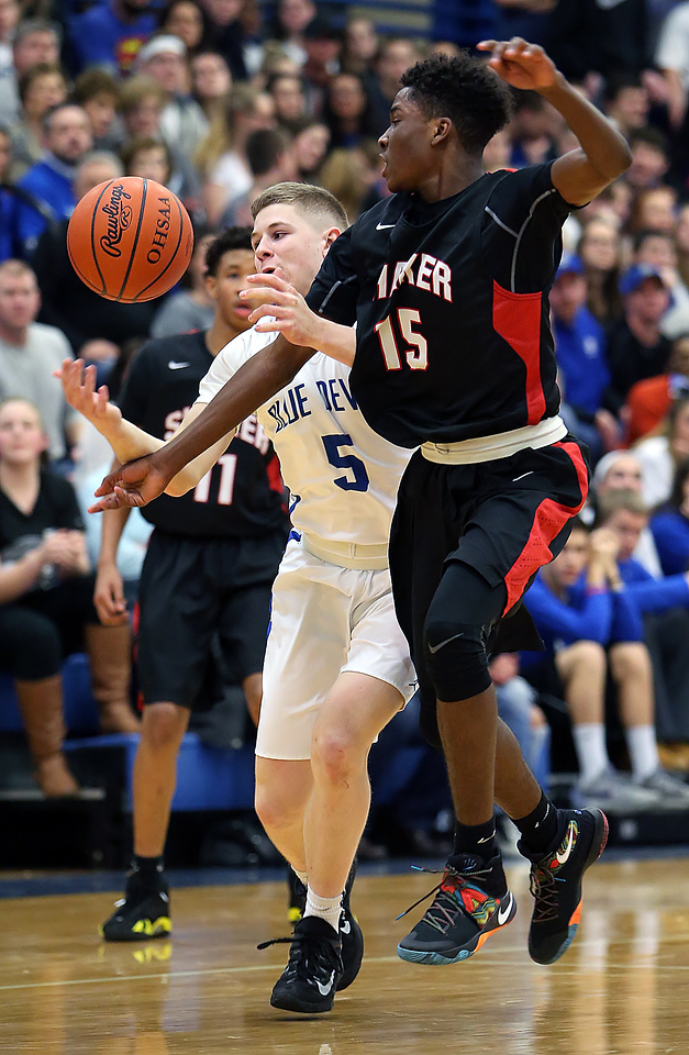 Brunswick's Austin Mick and Shaker Heights' Dale Bonner battle for a loose ball during the first quarter. (RON SCHWANE / GAZETTE)