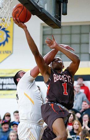 Buckeye's Justin Canedy goes up for a shot against Black River's Curtis Roupe during the first quarter. (RON SCHWANE / GAZETTE)