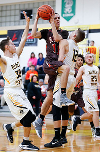 Buckeye's Joey Bartinelli goes up for a shot between Black River's Mike Hazlett (12) and Zach Hawley during the first quarter. (RON SCHWANE / GAZETTE)